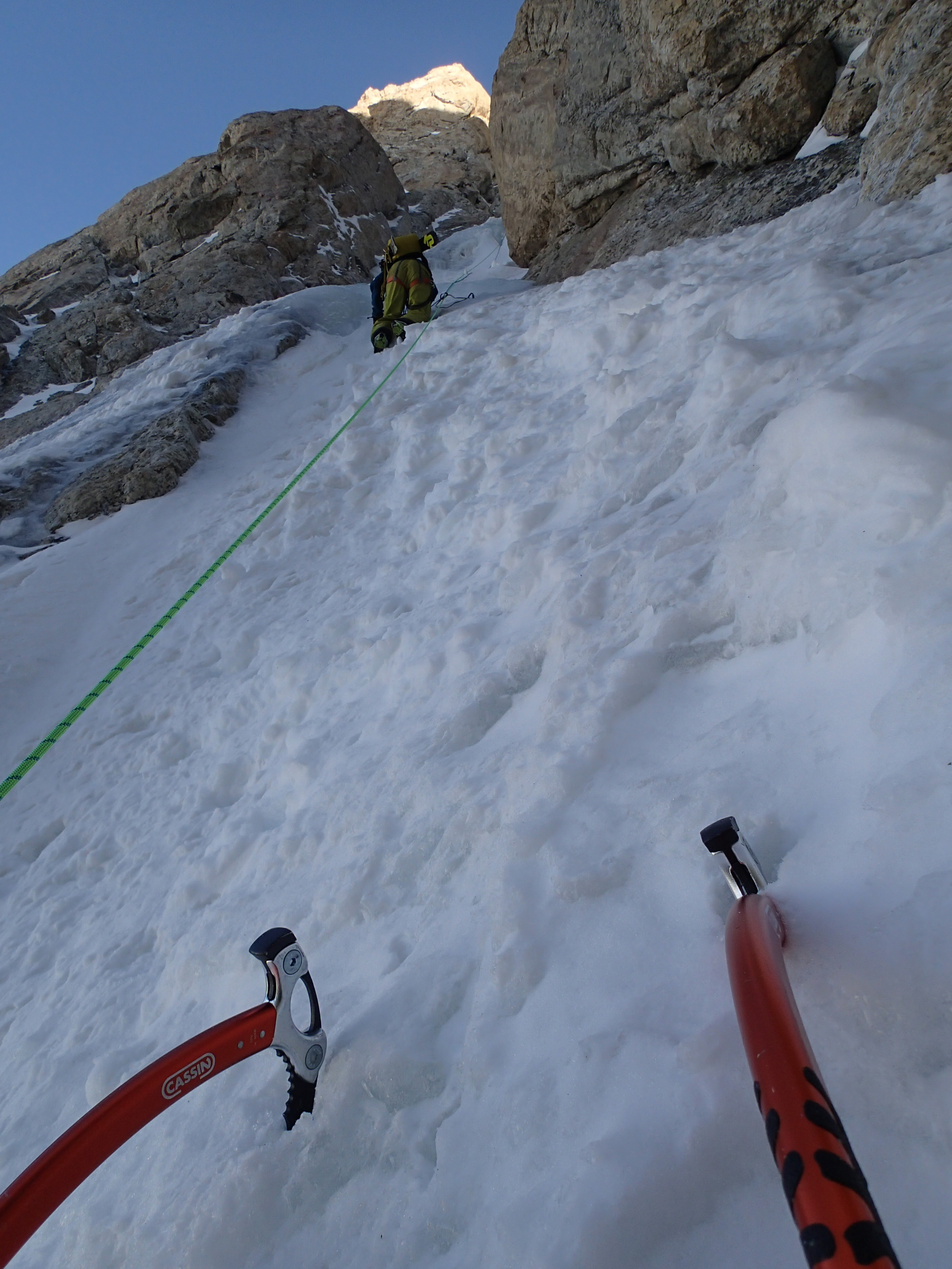Ice climbing with ice axes up the Grand Teton in winter